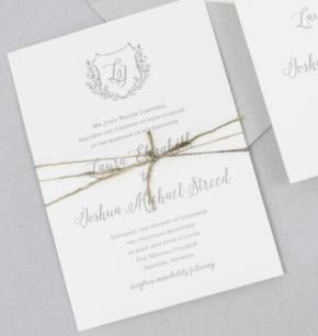 leafy branches monogram crest wedding invitations
