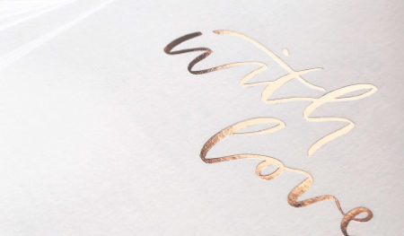 A close up of a A&P gold foil stamp